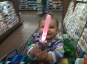 Anna holding a lightsaber.